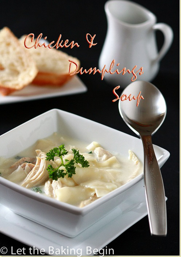 Chicken and dumplings soup topped with greens in a white bowl and white plate with a spoon.