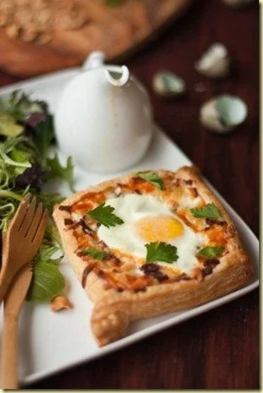 Egg tarts and green salad with a homemade honey mustard dressing on a plate.