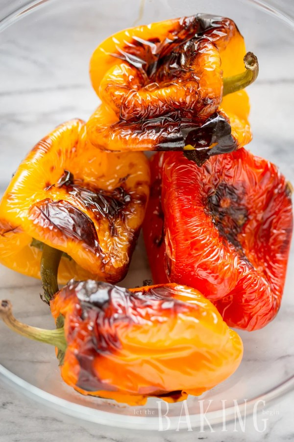 Roasted bell peppers in a glass bowl.