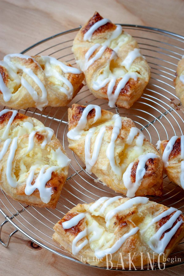 Cheesecake Danish is a puff pastry dessert that's filled with sweet cheesecake filling and drizzled with Lemon Sugar Glaze. Make it once and your family will ask you to make it time and time again. Ready in 30 minutes or less!