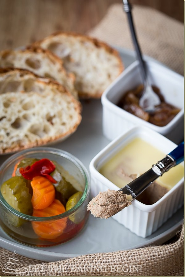 chicken liver mousse recipe made and served next to balsamic onions, vegetables, and bread all in a white plate.