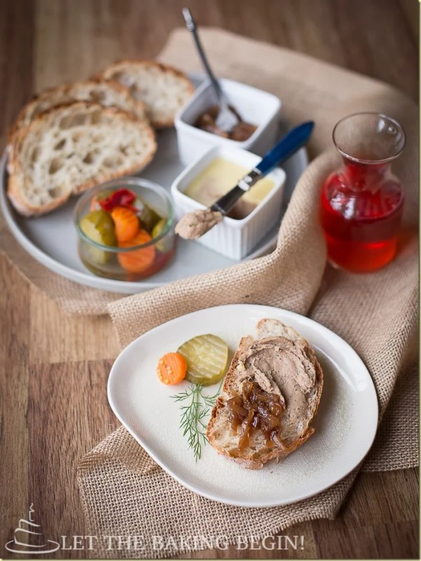 Chicken liver mousse recipe next to balsamic onions, vegetables, and bread on a white plate.