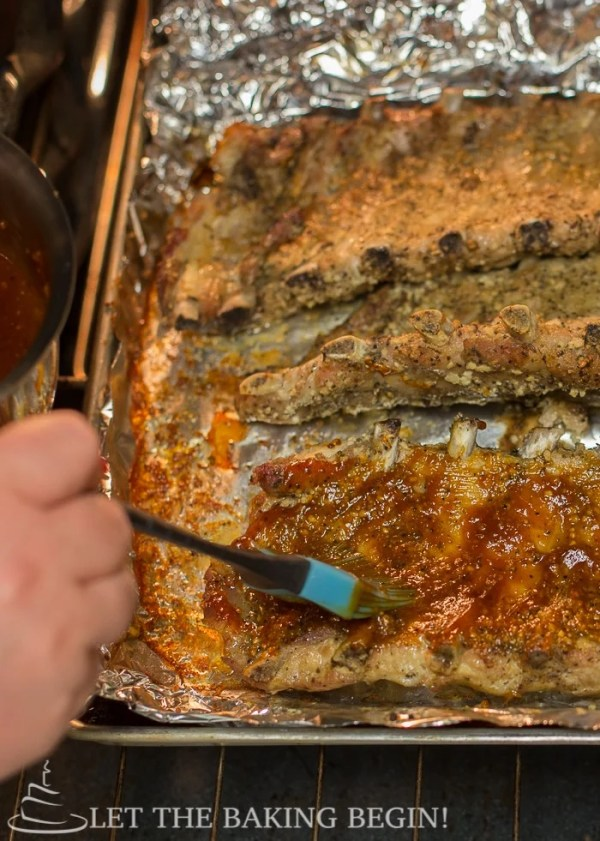 How to brush barbecue sauce on baked ribs.