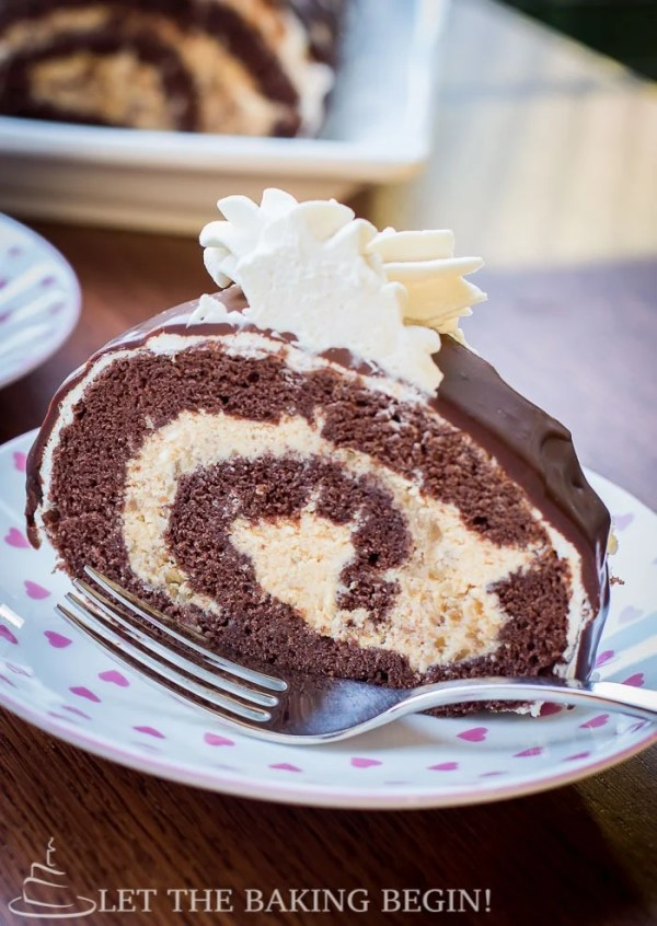 Close up of chocolate roll on a decorative plate.
