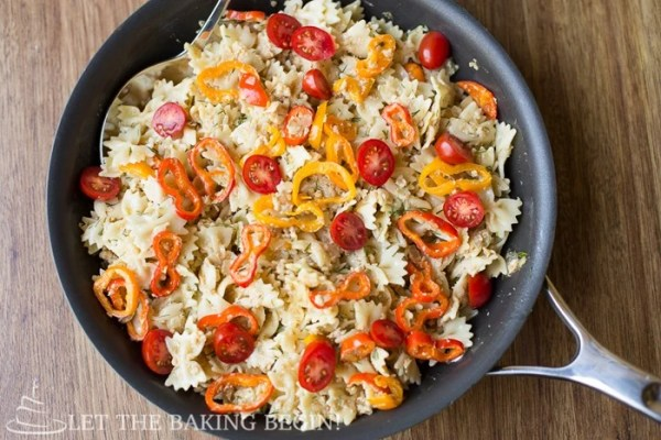 Pasta with ground turkey, peppers, tomatoes, and a creamy sauce in a skillet.