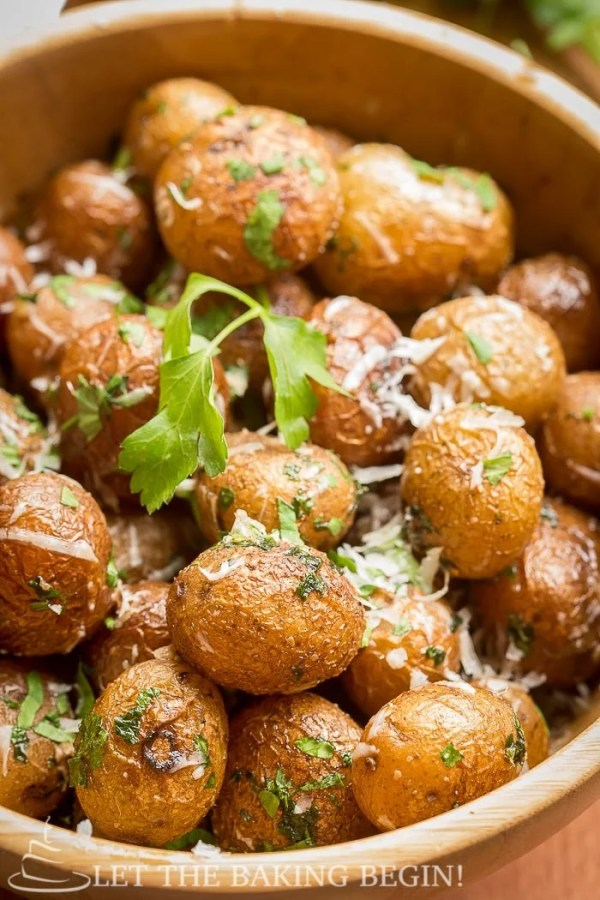 Pan Seared Parmesan Little Potatoes in a bowl topped with cheese and cilantro.