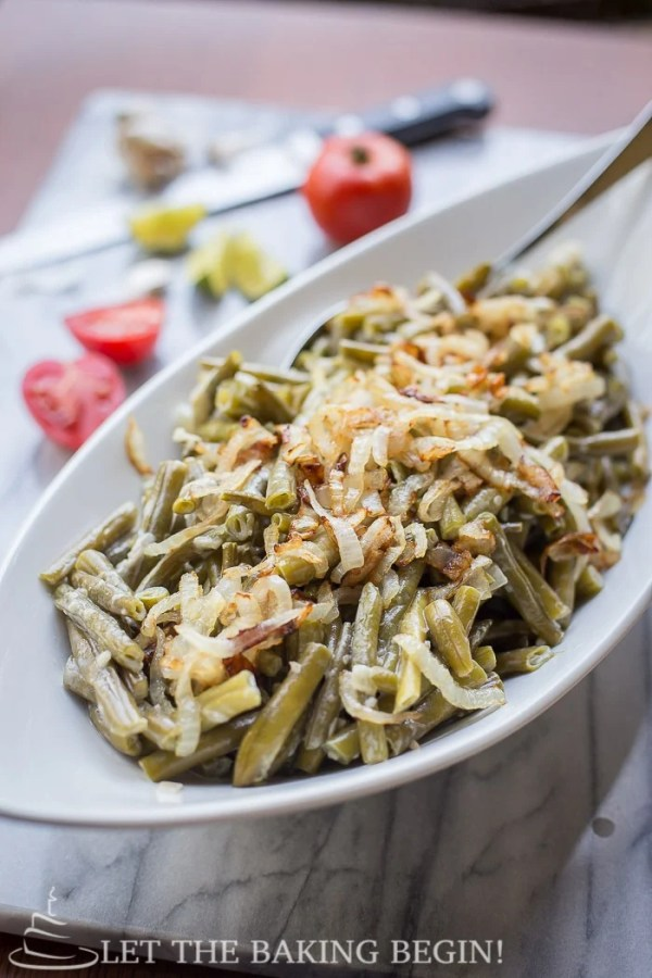 Creamy Garlic Parmesan Green Beans with sauteed onions, in a creamy garlic whipping sauce. Delicious green beans recipe.