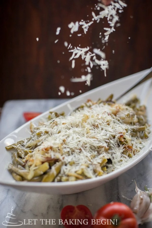 A delicious side dish green bean recipes with fresh Parmesan and a creamy garlic white sauce.