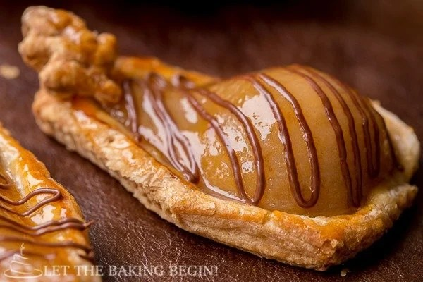 A poached pear in pastry topped with a Nutella drizzle.