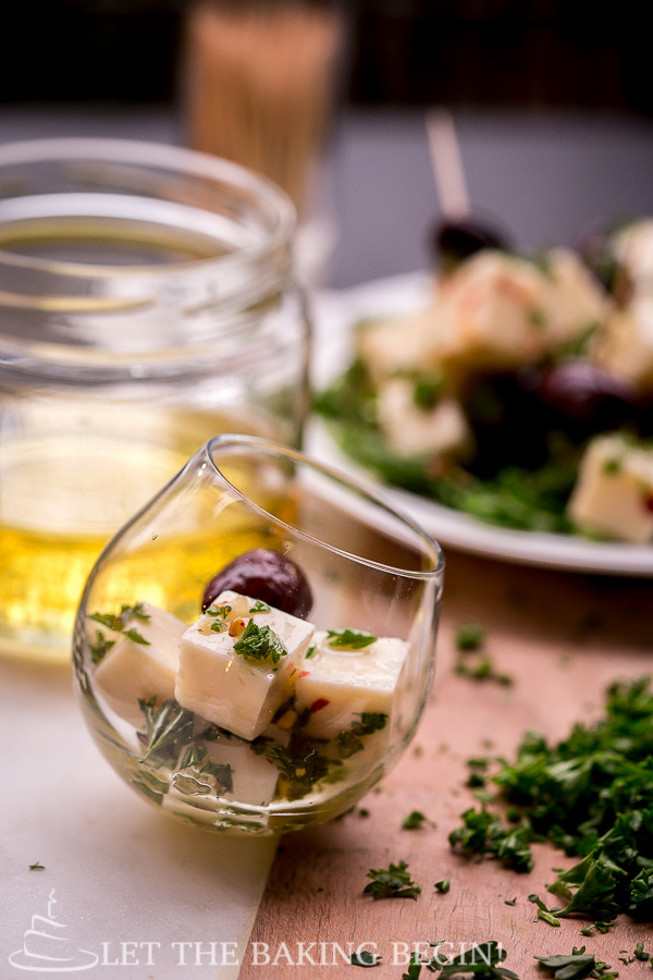 Marinated Cheese - combination of Darigold White Cheddar Cheese, garlic, parsley, olives and a splash of olive oil, served on a bed of baby rucola leaves.   @Letthebakingbgn
