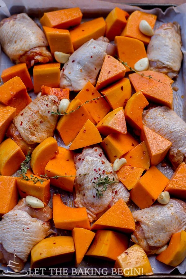 One Pan Chicken and Butternut Squash on a pan, ready to go into the oven.