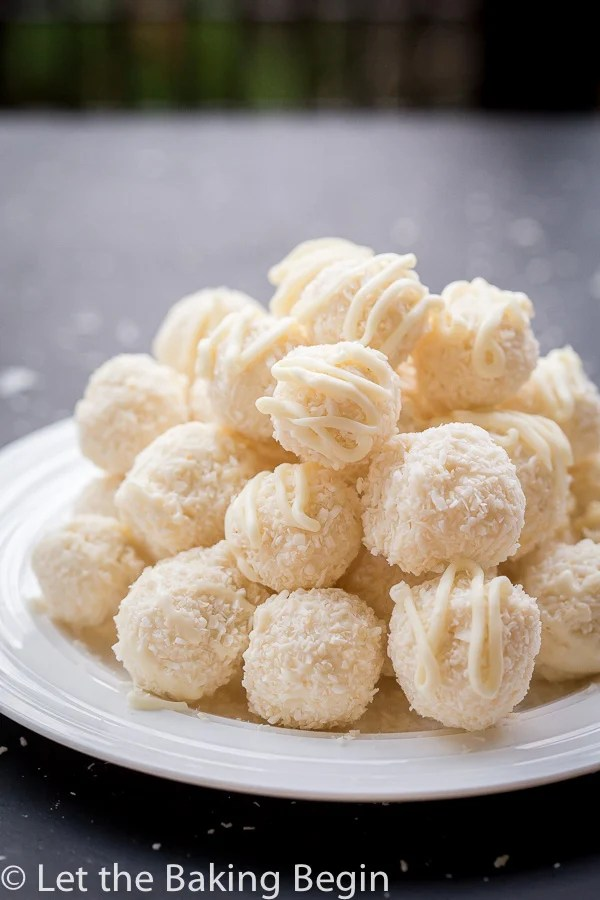 White chocolate coconut candies on a white plate.