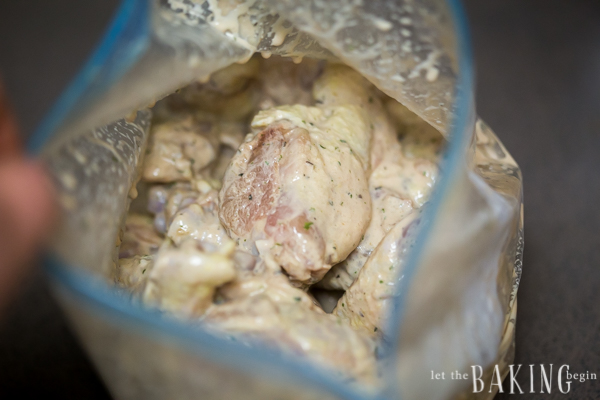 Garlic Ranch Chicken Wings in a bag with marinade mixture.