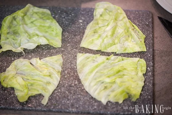 Cutting the large cabbage leaves in half.