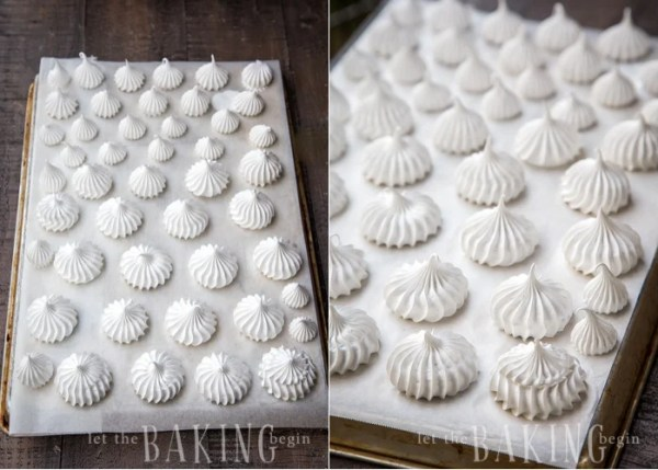 Piped out meringue cookies on a parchment lined baking sheet.