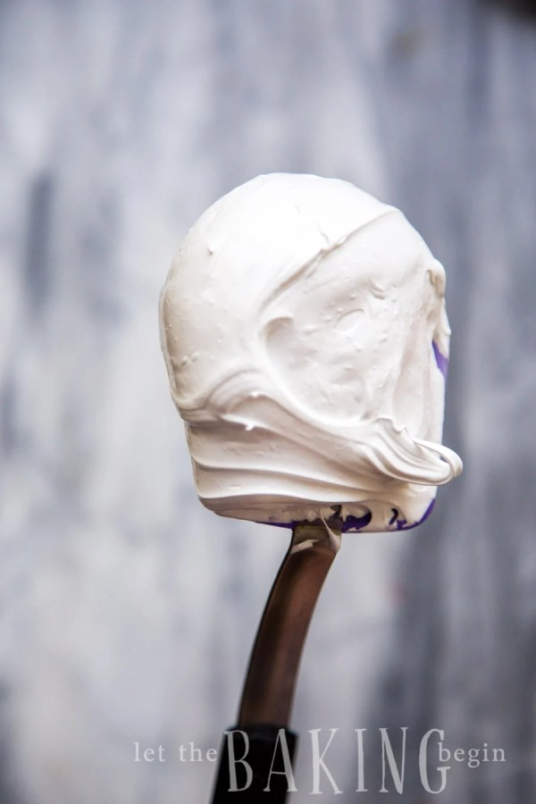 A spatula full of fluffy meringue.