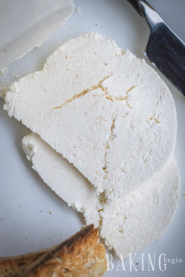 Top view of farmers cheese on a white plate.