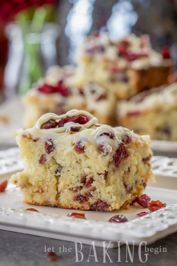 A slice of Cranberry Bliss Coffee Cake on a plate, topped with dried fruit.