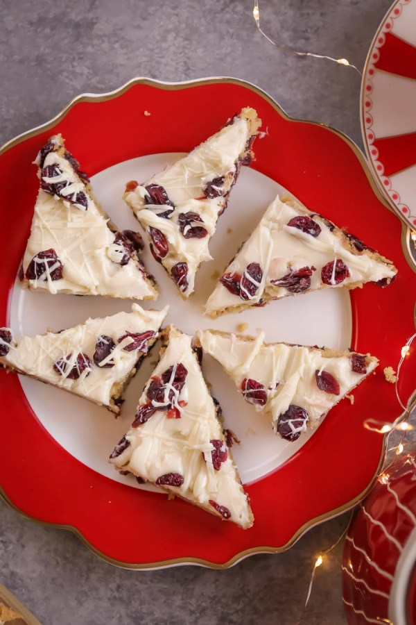 Six Cranberry Bliss Bar on a red and white plate.
