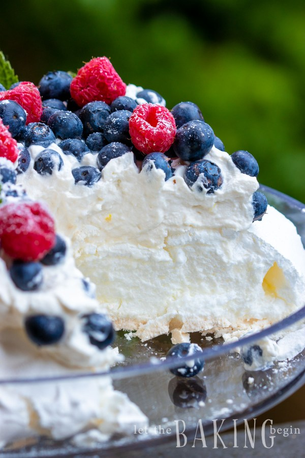 PavlovaCake is light as air, fluffy as the softest pillow, absolutely delightful meringue dessert that combines, marshmallowy pavlova cake, fluffy whipped cream and berries that come together into a delicious and simple dessert.