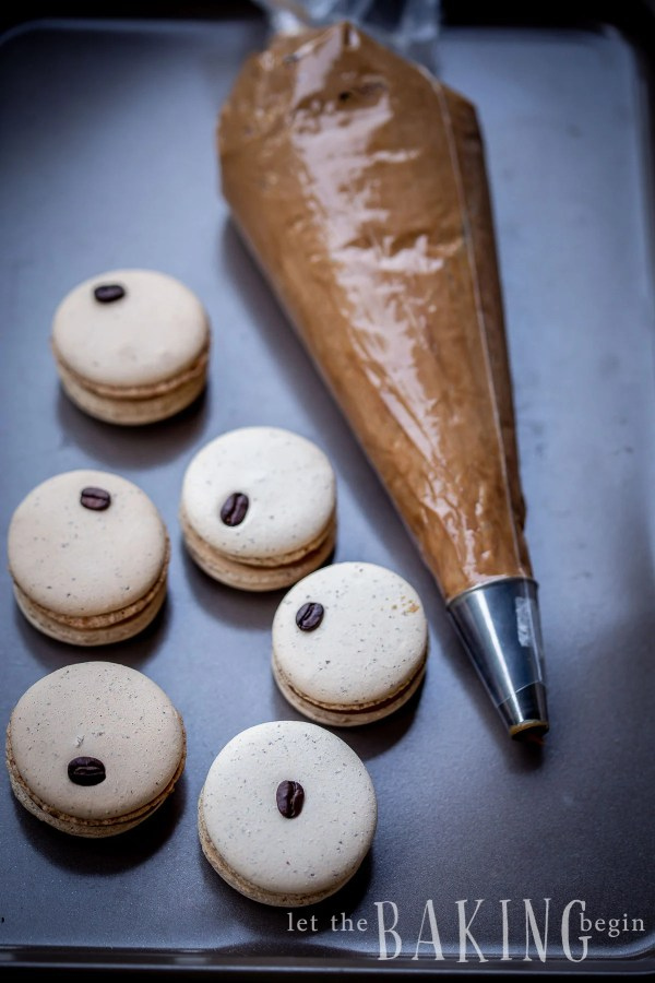 Coffee MacaronRecipe is a combination ofa creamy coffee flavoredwhite chocolate ganache and a basic macaron shell. They make amazing treats to go with coffee or tea, or as part of a potluck dessert tables at baby showers, birthdays or any other parties.