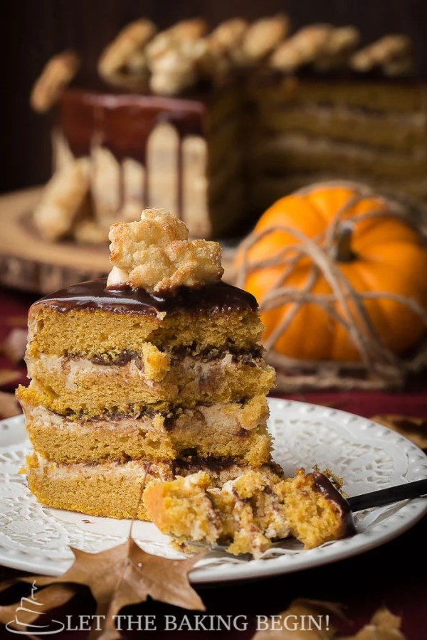This Moist and Delicious Layered Pumpkin Cake is made with FluffyCream Cheese Frosting and a drizzle of Chocolate. The Cream Cheese Frosting has some dulce de leche added, so you know it's extra good! Make this showstopper for Thanksgiving and you'll be the talk of the town, for sure!