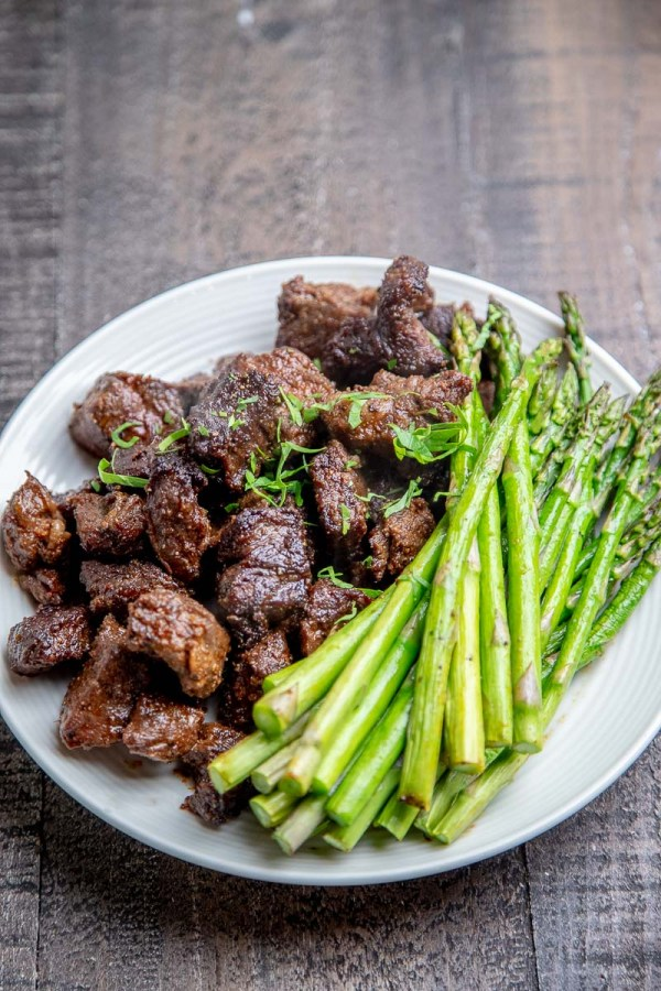 Air Fryer Steak Tips on a plate with asparagus