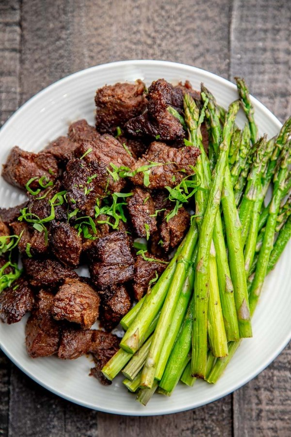 Air Fryer Steak Tips with Asparagus on a plate.