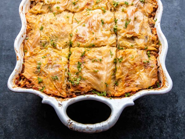Unstuffed Cabbage Rolls Casserole is made by layering the beef rice filling and softened cabbage leaves, rather then rolling each cabbage roll. All the great flavors, sans the extra work. Win- win!