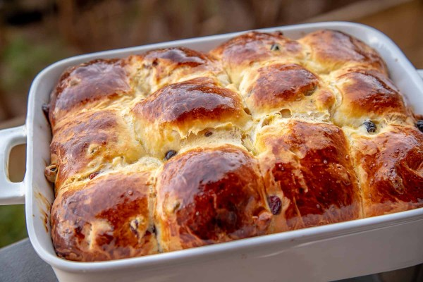 Hot Cross Buns are made with delicious buttery brioche dough, rum soaked dried blueberries, cranberries and white chocolate. This is THE recipe you need to make this Easter!