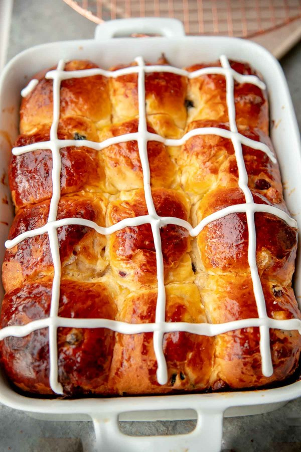 Hot Cross Buns are made with delicious buttery brioche dough, rum soaked fruits, and white chocolate. by Let the Baking Begin! @letthebakingbgn