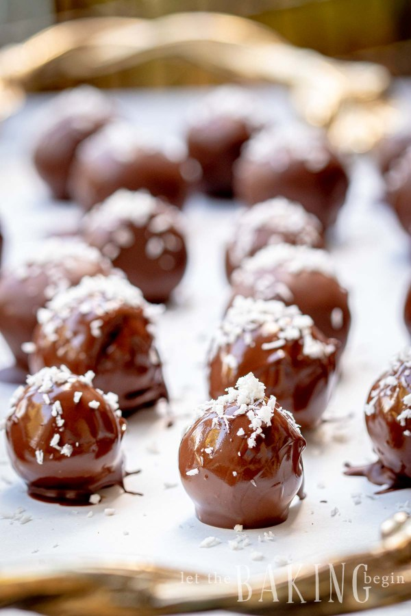 Coconut chocolate truffles still wet from being freshly made.