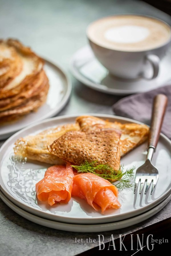 Smoked Salmon served with blinis on a plate.