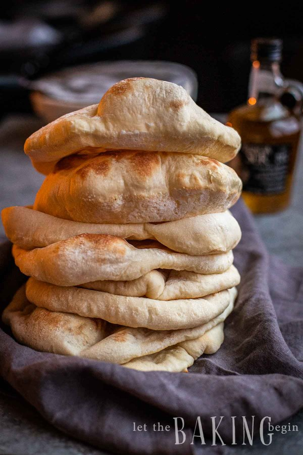 A tall stack of pita bread.