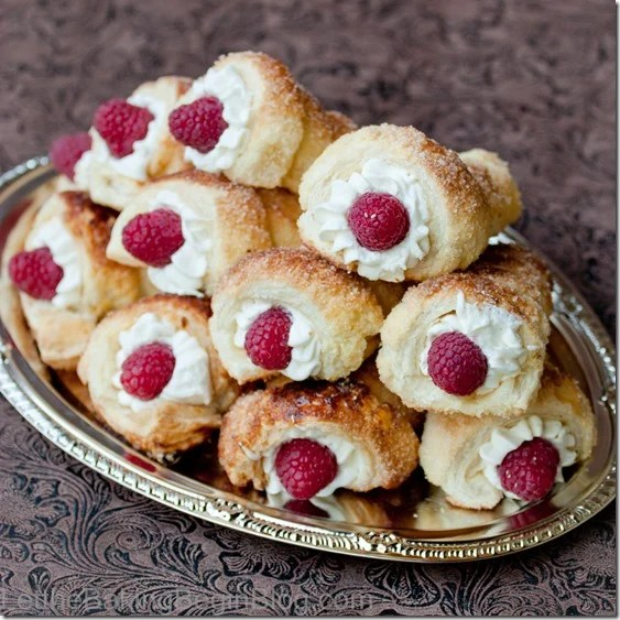 Puff Pastry Cream Horns with Luscious White Cream and Raspberries {Letthebakingbeginblog.com{