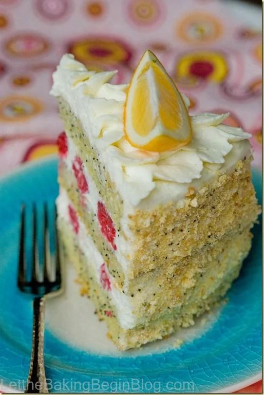 Moist lemon cake with Chantily Cream and Raspberries. by LetTheBakingBeginBlog.com