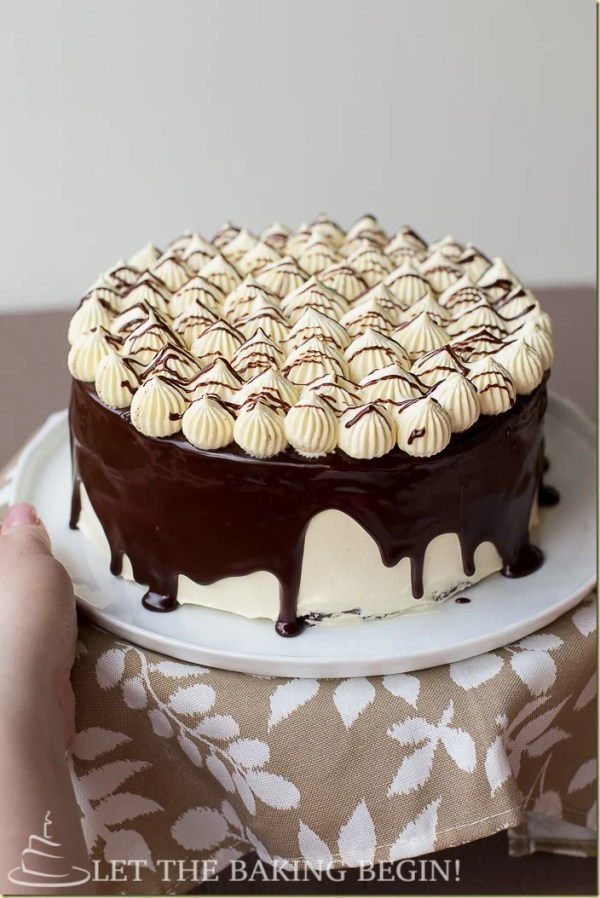 Moist Chocolate Cake filled with Luscious Custard Cream. The layer of Extra Glossy Chocolate Ganache on Top Brings this Cake Over the Top. Just the way any Chocolate Cake Should Be. by LettheBakingBeginBlog.com