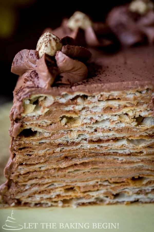 Chocolate Cake Mikado - thin, flaky cake layers that are frosted with Chocolate Custard Buttercream. | by LetTheBakingBeginBlog.com | @Letthebakingbgn