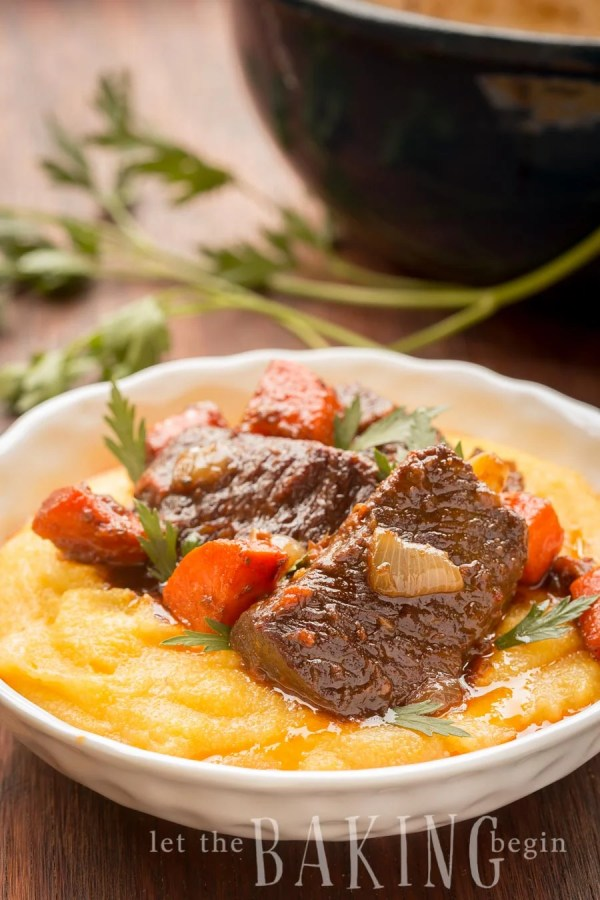 Braised Short Ribs are made with onions, carrots, splash of wine and good amount of garlic. Easy weeknight dinner or a weekend feast - you decide!