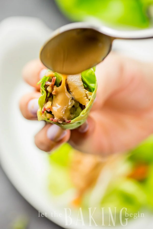 Thai Chicken Lettuce Wraps with Peanut Sauce - Perfect as a Light Dinner or a Fancy Appetizer. The Peanut Sauce can be used for Wraps, Salads and even Thai style pasta.