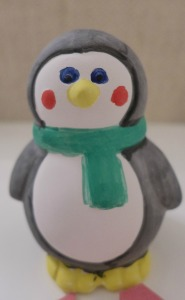 baker Ross ceramic penguin coin bank