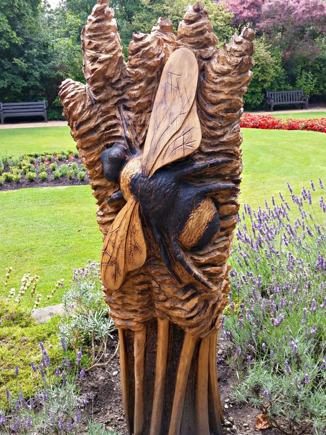 carved bee parsonage gardens disbury