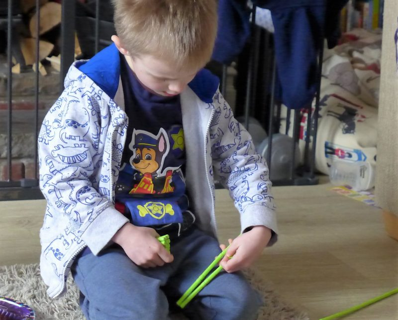child playing with geomag panels set