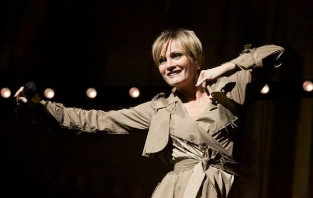 Patricia Kaas in her ivory imperméable... Photo by ABACA...