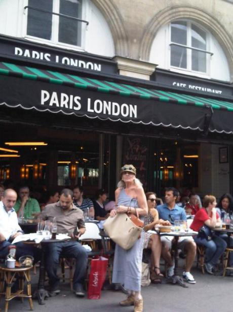 In front of the.. Paris London café...