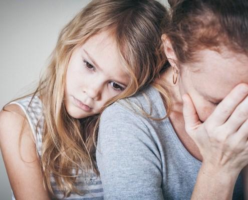 child hugging mom untreated depression