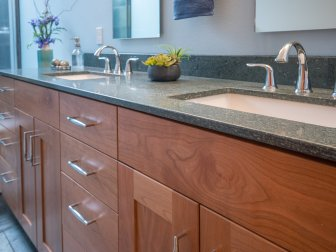 Transitional modern bathroom with wood cabinets and granite countertops