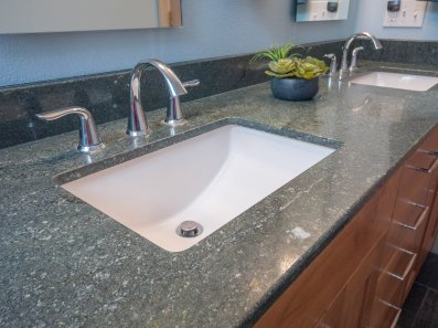 Transitional style bathroom with granite countertops and modern fixtures