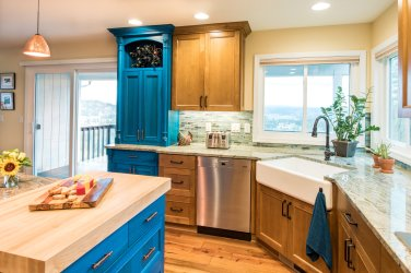 This transitional kitchen remodel combines natural light with modern fixtures.