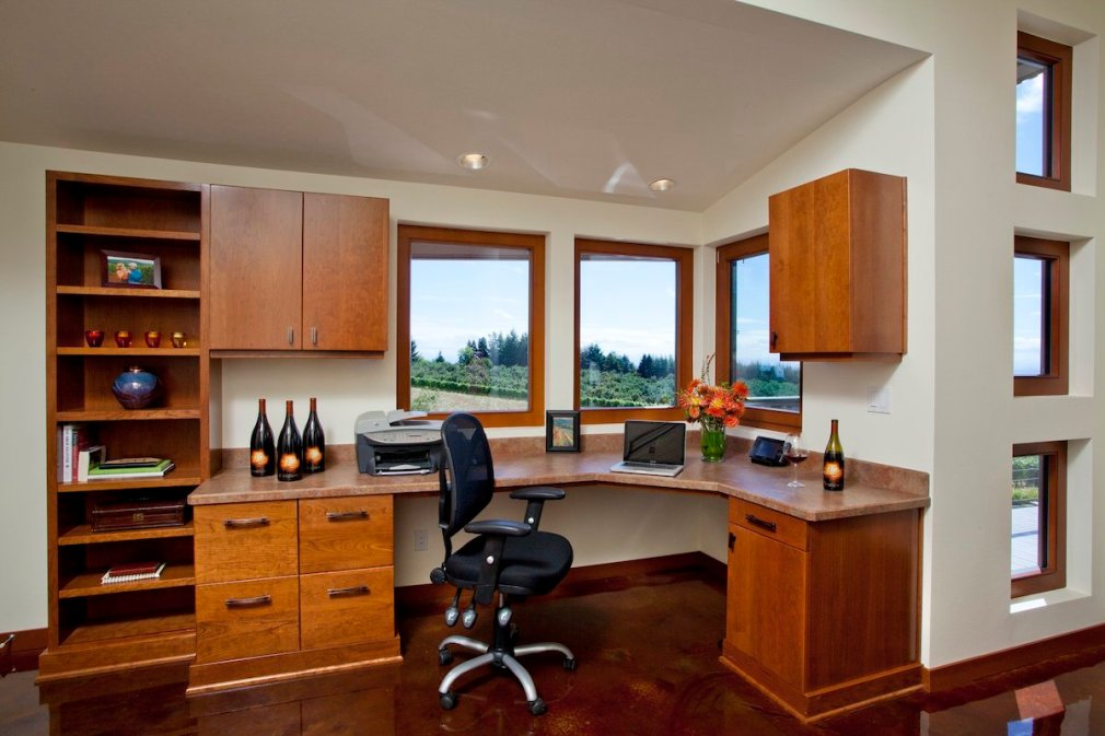 home office remodel with windows and a curved desk